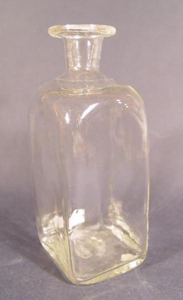 f142 / Alte Flasche, farbloses Glas optischgeblasen mit Abriss.
