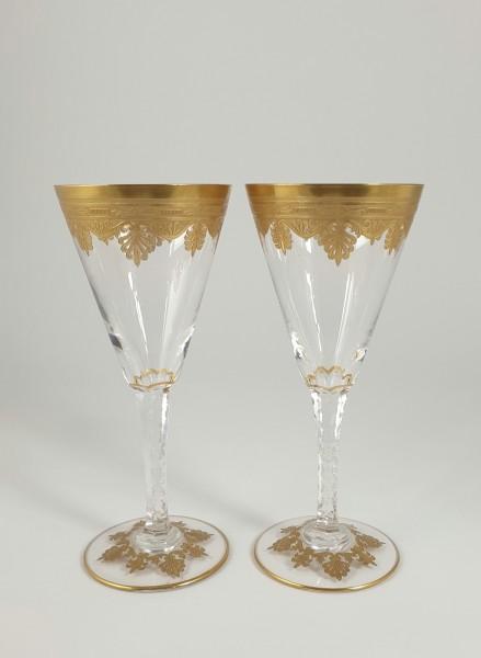 2 Sekt-, Weingläser, reich vergoldet.